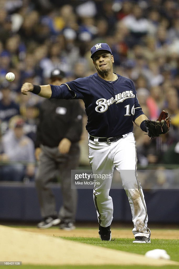Third baseman Aramis Ramirez #16 of the Milwaukee Brewers makes the throw to first base to get Dexter Fowler of the Colorado Rockies out in the top of the seventh inning at Miller Park on April 3, 2013 in Milwaukee, Wisconsin.