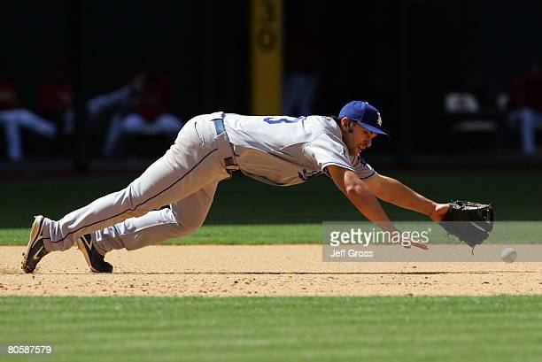 Third baseman Blake Dewitt of the Los Angeles Dodgers dives but can't come up with the ball a single by Chris Burke of the Arizona Diamondbacks in...