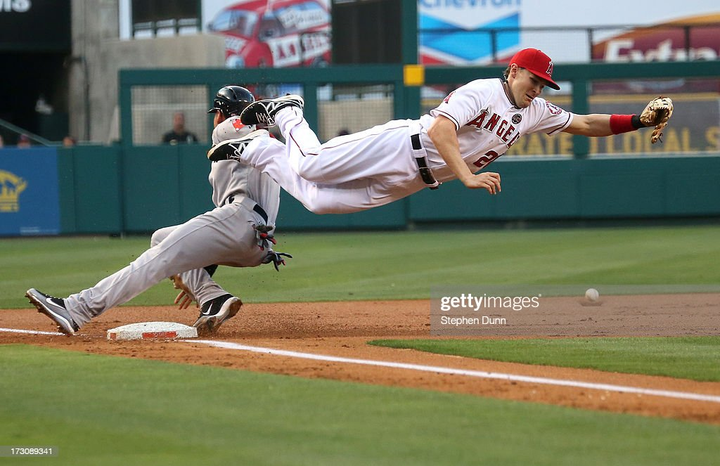 Third baseman <a gi-track='captionPersonalityLinkClicked' href=/galleries/search?phrase=Brendan+Harris&family=editorial&specificpeople=534816 ng-click='$event.stopPropagation()'>Brendan Harris</a> #20 of the Los Angeles Angels of Anaheim can't reach a throw from catcher Chris Ianetta #17 as jacooby Ellsworth #2 of the Boston Red Sox steals third base in the first inning at Angel Stadium of Anaheim on July 6, 2013 in Anaheim, California. Ellsbury then scored on the throwing error.