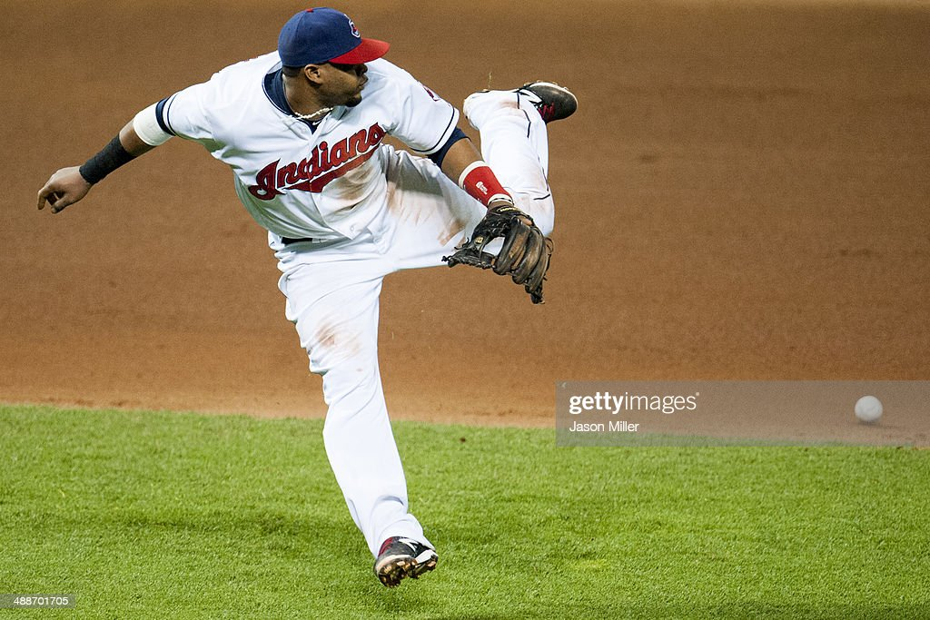 Third baseman Carlos Santana #41 of the Cleveland Indians misses a ground ball hit by Sam Fuld #1 of the Minnesota Twins during the seventh inning at Progressive Field on May 7, 2014 in Cleveland, Ohio. The Indians defeated the Twins 4-3.