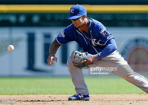 Third baseman Cheslor Cuthbert of the Kansas City Royals loses the ball while transferring it on a hit by Justin Upton of the Detroit Tigers during...