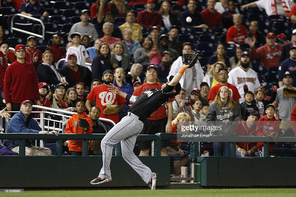 Third baseman <a gi-track='captionPersonalityLinkClicked' href=/galleries/search?phrase=Chris+Coghlan&family=editorial&specificpeople=4391543 ng-click='$event.stopPropagation()'>Chris Coghlan</a> #8 of the Miami Marlins catches a foul pop by Bryce Harper #34 (not pictured) of the Washington Nationals during the fifth inning in game 2 of their day-night doubleheader at Nationals Park on September 22, 2013 in Washington, DC.