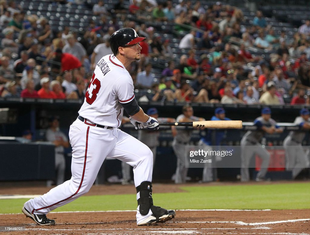 Third baseman Chris Johnson of the Atlanta Braves follows through on a swing during the game against the New York Mets at Turner Field on September 3...