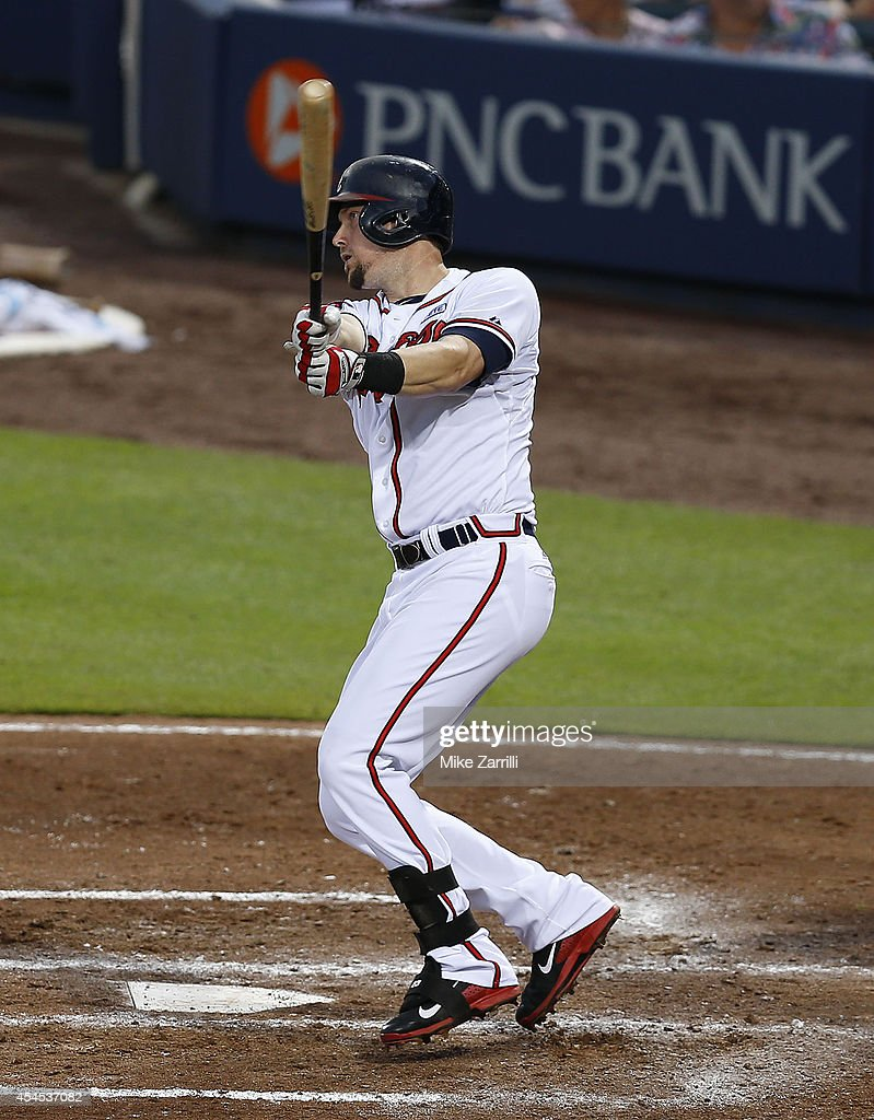 Third baseman Chris Johnson of the Atlanta Braves follows through on a swing during the game against the Los Angeles Dodgers at Turner Field on...
