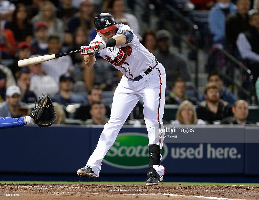Third baseman Chris Johnson of the Atlanta Braves jumps out of the way on a pitch during the game against the New York Mets at Turner Field on April...
