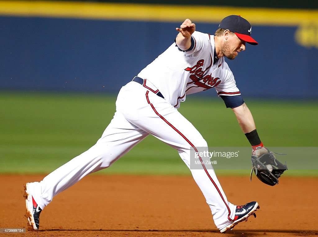 Third baseman Chris Johnson of the Atlanta Braves makes a play on a short hop during the game against the Miami Marlins at Turner Field on April 13...