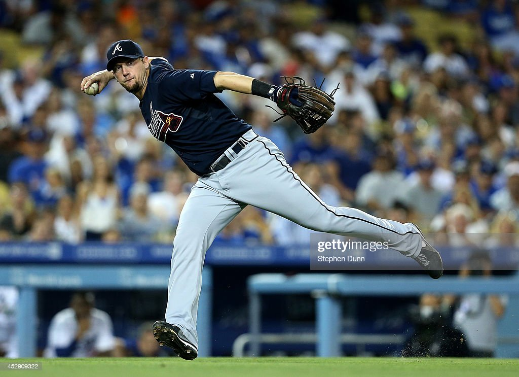 Third baseman Chris Johnson of the Atlanta Braves throws to first to get the out after fielding a bunt by Dee Gordon of the Los Angeles Dodgers in...