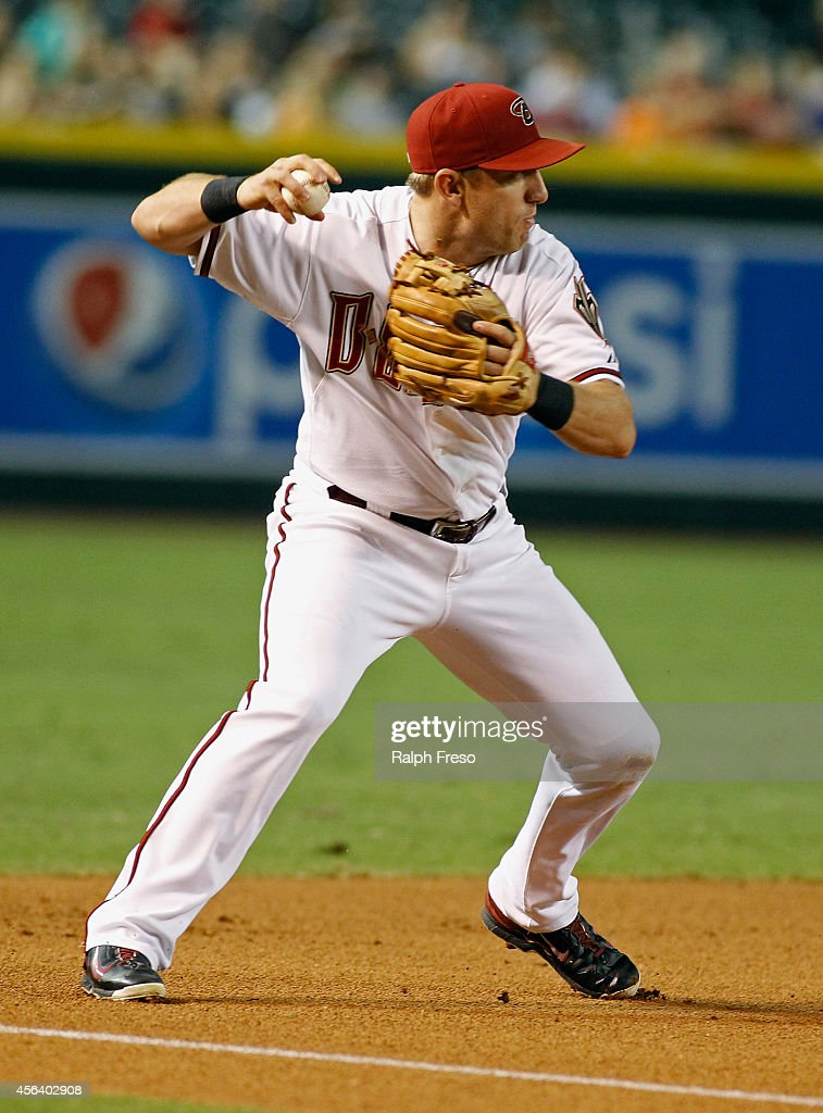 Third baseman Cliff Pennington of the Arizona Diamondbacks throws to first on a ground ball against the San Francisco Giants during the second inning...