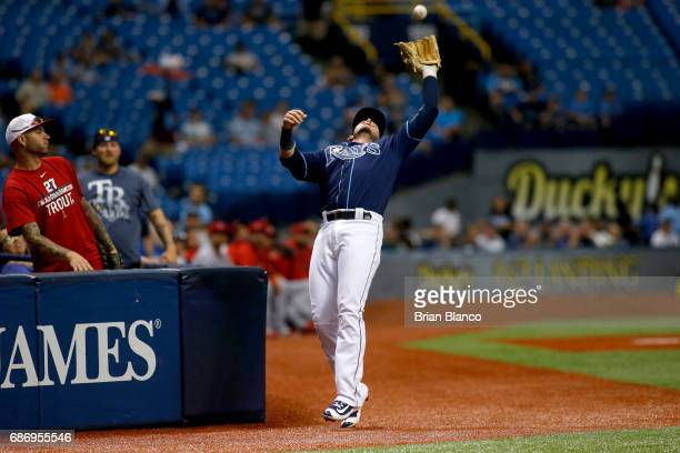 Third baseman Daniel Robertson of the Tampa Bay Rays hauls in the foul ball by Albert Pujols of the Los Angeles Angels during the first inning of a...