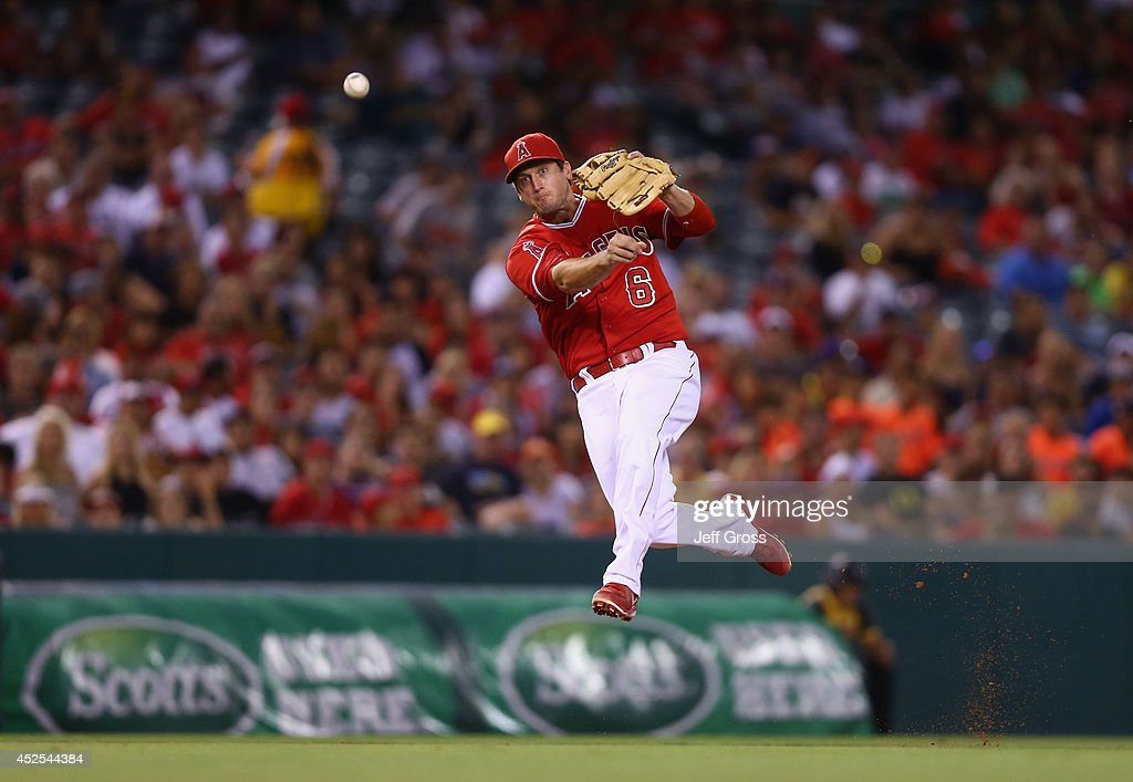 Third baseman <a gi-track='captionPersonalityLinkClicked' href=/galleries/search?phrase=David+Freese+-+Baseball+Player&family=editorial&specificpeople=4948315 ng-click='$event.stopPropagation()'>David Freese</a> #6 of the Los Angeles Angels of Anaheim makes a throw to first but isn't able to get Chris Davis of the Baltimore Orioles out in the sixth inning at Angel Stadium of Anaheim on July 22, 2014 in Anaheim, California.