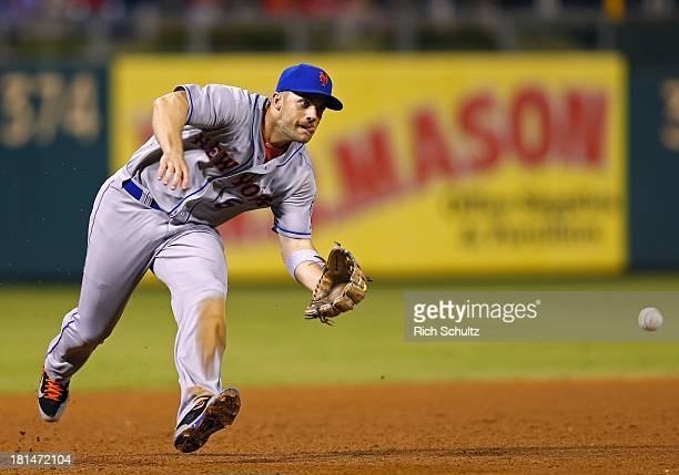 Third baseman David Wright of the New York Mets fields a ground ball and throws to first base to get Carlos Ruiz of the Philadelphia Phillies during...