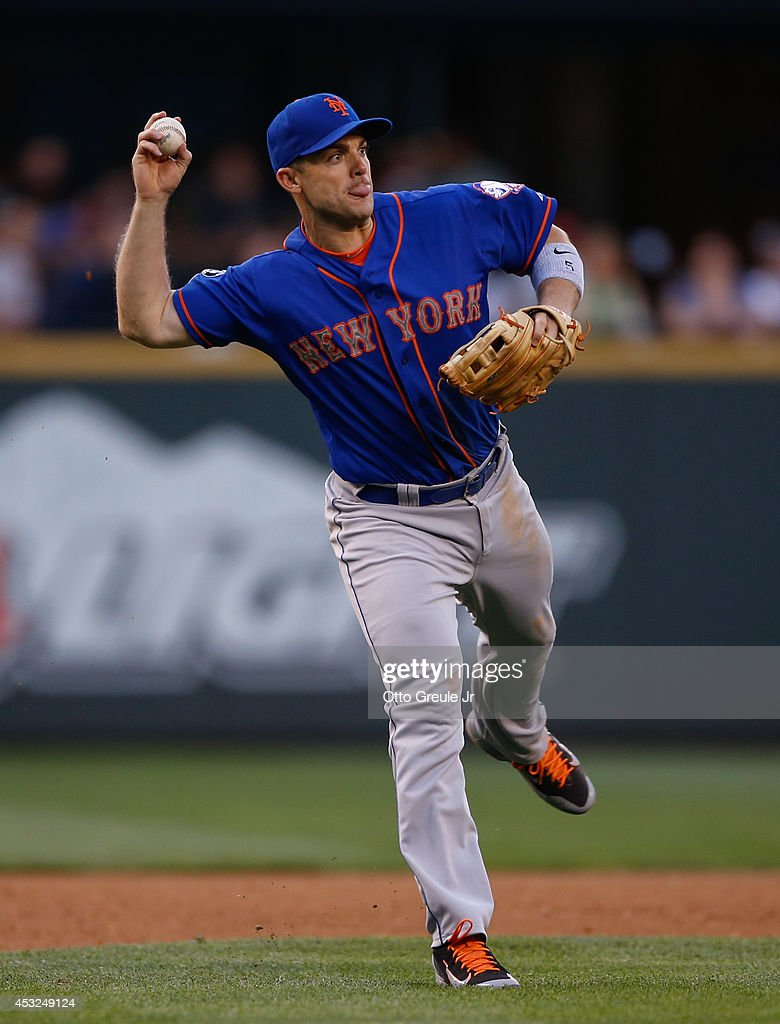 Third baseman David Wright #5 of the New York Mets throws to first base on a groundout play against the Seattle Mariners at Safeco Field on July 21, 2014 in Seattle, Washington.