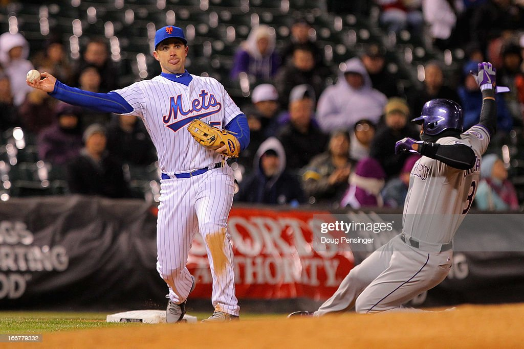 Third baseman <a gi-track='captionPersonalityLinkClicked' href=/galleries/search?phrase=David+Wright+-+Baseball+Player&family=editorial&specificpeople=209172 ng-click='$event.stopPropagation()'>David Wright</a> #5 of the New York Mets truns a double play on <a gi-track='captionPersonalityLinkClicked' href=/galleries/search?phrase=Yorvit+Torrealba&family=editorial&specificpeople=212721 ng-click='$event.stopPropagation()'>Yorvit Torrealba</a> #8 of the Colorado Rockies on an attempted bunt by Jeff Francis of the Colorado Rockies in the fifth inning at Coors Field on April 16, 2013 in Denver, Colorado.