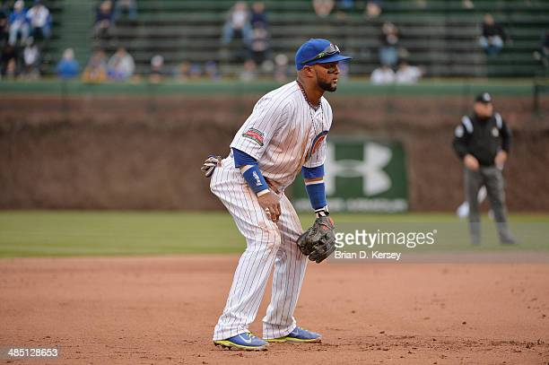 Third baseman Emilio Bonifacio of the Chicago Cubs gets ready for the pitch during the eighth inning against the Pittsburgh Pirates at Wrigley Field...