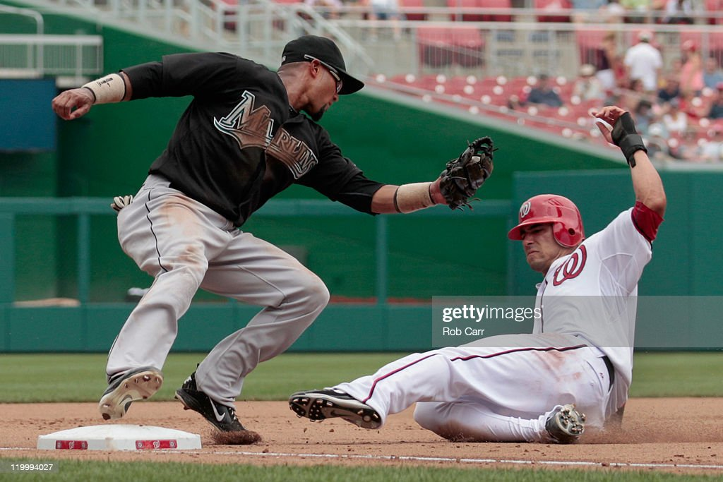 Third baseman <a gi-track='captionPersonalityLinkClicked' href=/galleries/search?phrase=Emilio+Bonifacio&family=editorial&specificpeople=4193706 ng-click='$event.stopPropagation()'>Emilio Bonifacio</a> #1 of the Florida Marlins prepares to tag out <a gi-track='captionPersonalityLinkClicked' href=/galleries/search?phrase=Ian+Desmond&family=editorial&specificpeople=835572 ng-click='$event.stopPropagation()'>Ian Desmond</a> #6 of the Washington Nationals stealing for the third out of the foruth inning at Nationals Park on July 28, 2011 in Washington, DC.