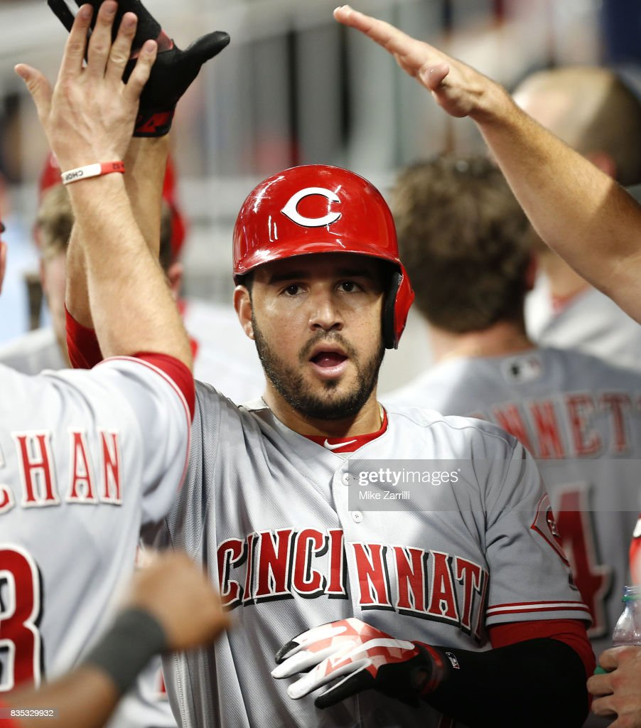 Third baseman Eugenio Suarez #7 of the Cincinnati Reds celebrates in the dugout after his solo home run in the sixth inning during the game against the Atlanta Braves at SunTrust Park on August 18, 2017 in Atlanta, Georgia.