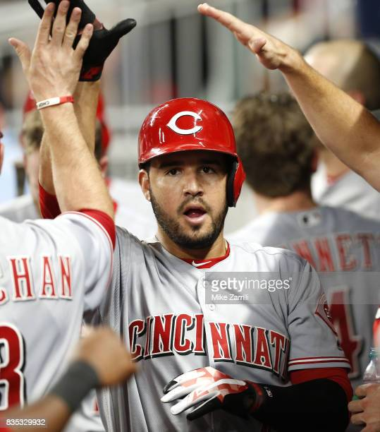 Third baseman Eugenio Suarez of the Cincinnati Reds celebrates in the dugout after his solo home run in the sixth inning during the game against the...