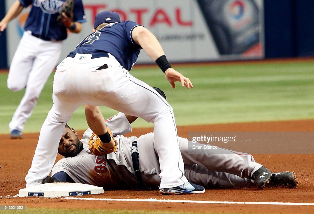 Third baseman <a gi-track='captionPersonalityLinkClicked' href=/galleries/search?phrase=Evan+Longoria&family=editorial&specificpeople=2349329 ng-click='$event.stopPropagation()'>Evan Longoria</a> #3 of the Tampa Bay Rays catches <a gi-track='captionPersonalityLinkClicked' href=/galleries/search?phrase=Jackie+Bradley+-+Baseball+Player&family=editorial&specificpeople=15049465 ng-click='$event.stopPropagation()'>Jackie Bradley</a> Jr. #25 of the Boston Red Sox attempting to steal third base to end the top of the top of the fifth inning of a game on June 29, 2016 at Tropicana Field in St. Petersburg, Florida.