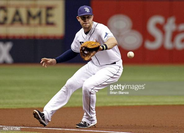 Third baseman Evan Longoria of the Tampa Bay Rays hauls in the ground ball by James Jones of the Seattle Mariners during the first inning of a game...
