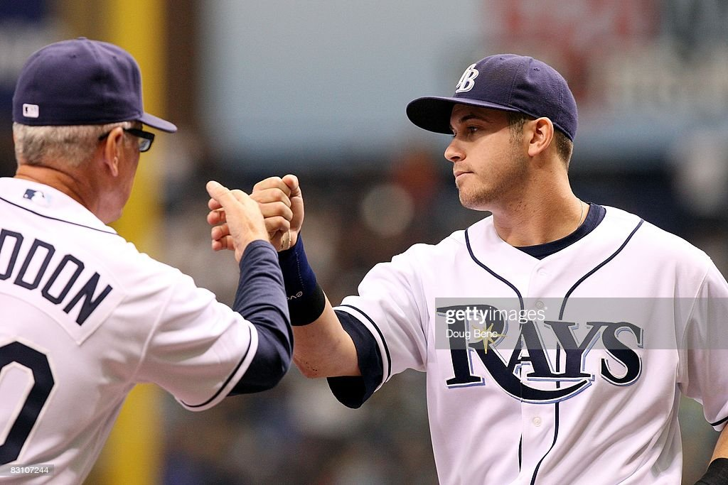Third baseman Evan Longoria #3 of the Tampa Bay Rays is greeted by manager Joe Maddon #70 while being announced before taking on the Chicago White Sox in Game 1 of the American Leaugue Divisional Series at Tropicana Field on October 2, 2008 in St. Petersburg, Florida. The Rays defeated the White Sox 6-4.