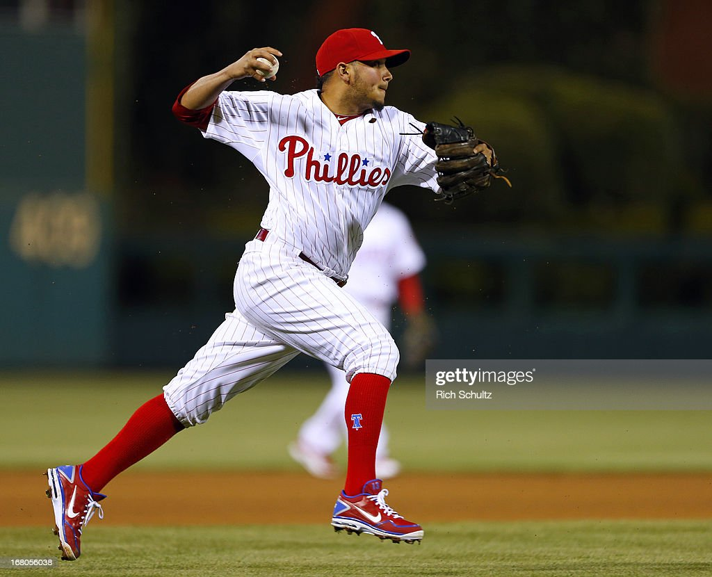 Third baseman Freddy Galvis #13 of the Philadelphia Phillies throws out Adeiny Hechavarria of the Miami Marlins at first base in the seventh inning of a MLB baseball game on May 4, 2013 at Citizens Bank Park in Philadelphia, Pennsylvania. The Marlins defeated the Phillies 2-0.