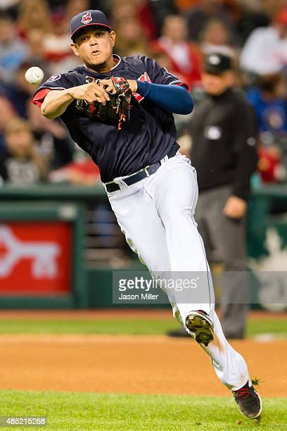 Third baseman Giovanny Urshela of the Cleveland Indians throws out Domingo Santana of the Milwaukee Brewers at first base during the seventh inning...