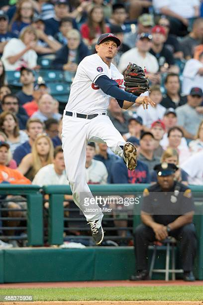 Third baseman Giovanny Urshela of the Cleveland Indians throws out Brett Gardner of the New York Yankees at first during the fourth inning at...