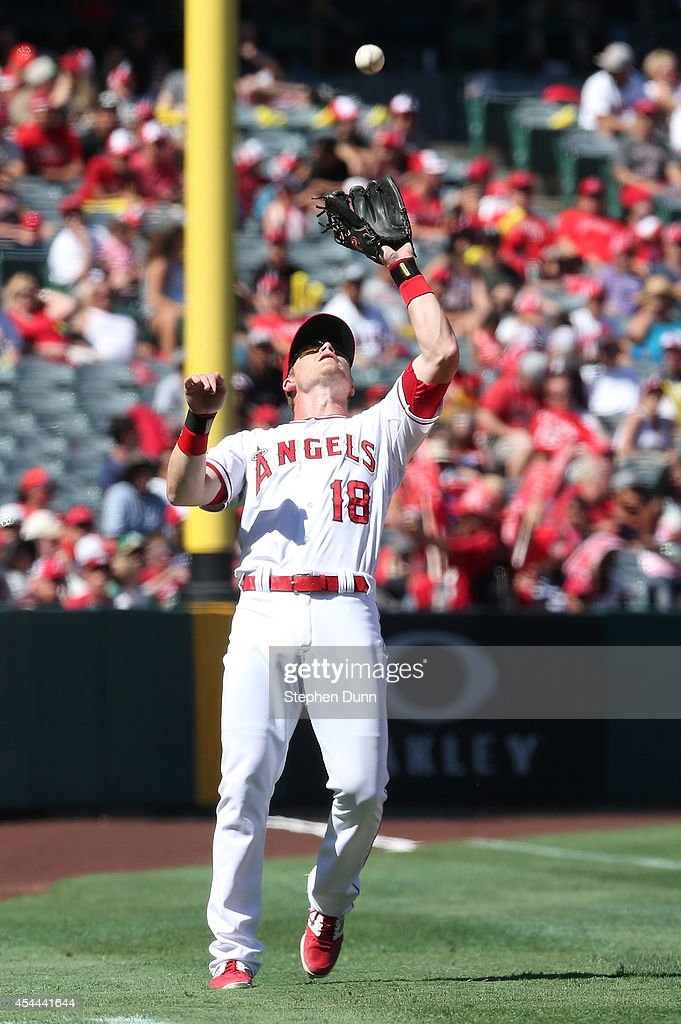 Third baseman <a gi-track='captionPersonalityLinkClicked' href=/galleries/search?phrase=Gordon+Beckham&family=editorial&specificpeople=5411079 ng-click='$event.stopPropagation()'>Gordon Beckham</a> #18 of the Los Angeles Angels of Anaheim coaches a foul popup off the bat of Alberto Callaspo of the Oakland Athletics in the seventh inning at Angel Stadium of Anaheim on August 31, 2014 in Anaheim, California. The Angels won 8-1 to complete a four game sweep.