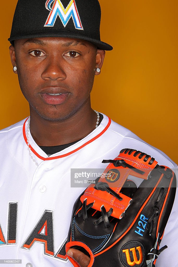 Third baseman <a gi-track='captionPersonalityLinkClicked' href=/galleries/search?phrase=Hanley+Ramirez&family=editorial&specificpeople=538406 ng-click='$event.stopPropagation()'>Hanley Ramirez</a> #2 of the Miami Marlins poses for photos during media day at Roger Dean Stadium on February 27, 2012 in Jupiter, Florida.