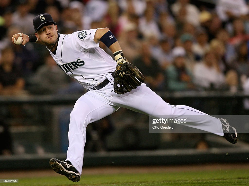 Third baseman Jack Hannahan of the Seattle Mariners fields a bunt base hit by Cliff Pennington of the Oakland Athletics on August 25 2009 at Safeco...