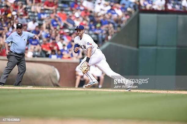 Third baseman Joey Gallo of the Texas Rangers reacts to catch a ball hit down the third base line in the game against the Minnesota Twins at Globe...