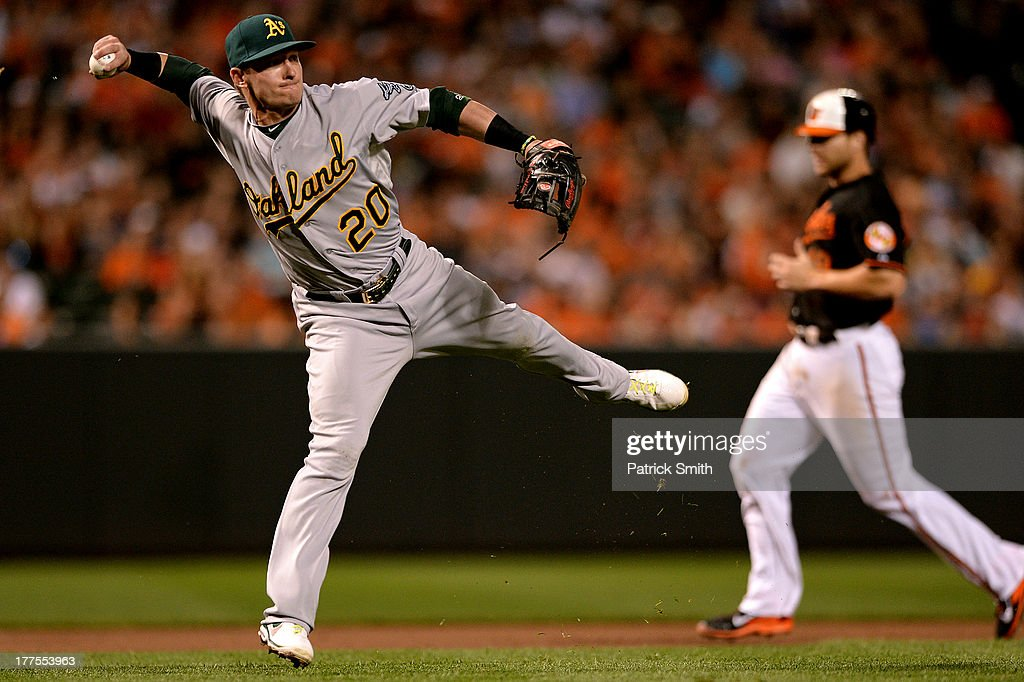 Third baseman <a gi-track='captionPersonalityLinkClicked' href=/galleries/search?phrase=Josh+Donaldson&family=editorial&specificpeople=4959442 ng-click='$event.stopPropagation()'>Josh Donaldson</a> #20 of the Oakland Athletics cannot throw out Matt Wieters of the Baltimore Orioles (not pictured) in the seventh inning at Oriole Park at Camden Yards on August 23, 2013 in Baltimore, Maryland. The Baltimore Orioles won, 9-7.