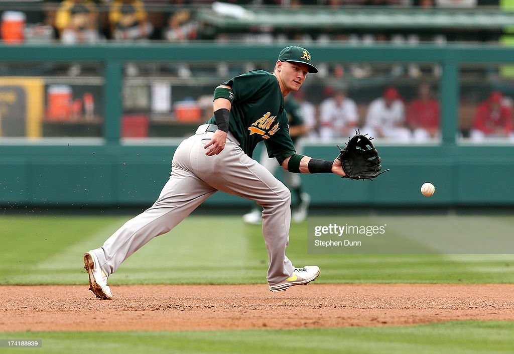 Third baseman <a gi-track='captionPersonalityLinkClicked' href=/galleries/search?phrase=Josh+Donaldson&family=editorial&specificpeople=4959442 ng-click='$event.stopPropagation()'>Josh Donaldson</a> #20 of the Oakland Athletics fields a ground ball hit by Alert Pujols #5 of the Los Angeles Angels of Anaheim to end the first inning at Angel Stadium of Anaheim on July 21, 2013 in Anaheim, California.