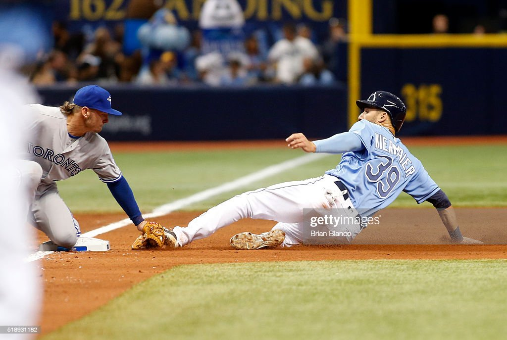 Third baseman Josh Donaldson #20 of the Toronto Blue Jays catches Kevin Kiermaier #39 of the Tampa Bay Rays attempting to steal third base to end the fourth inning of a game on April 3, 2016 at Tropicana Field in St. Petersburg, Florida.