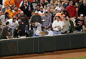Third baseman Josh Donaldson of the Toronto Blue Jays misses a foul ball hit by Mark Trumbo of the Baltimore Orioles in the third inning at Oriole...