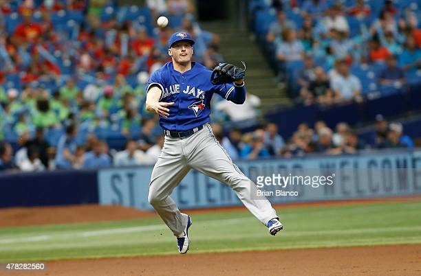 Third baseman Josh Donaldson of the Toronto Blue Jays throws out Brandon Guyer of the Tampa Bay Rays at first during the third inning of a game on...