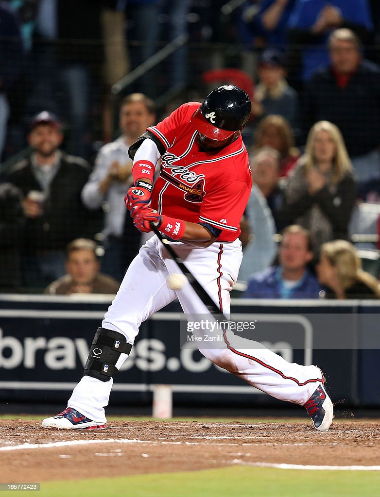 Third baseman Juan Francisco #25 of the Atlanta Braves connects for a two-run single in the fifth inning during the game against the Chicago Cubs at Turner Field on April 5, 2013 in Atlanta, Georgia.