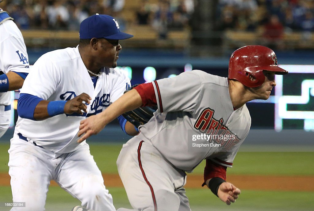 Third baseman <a gi-track='captionPersonalityLinkClicked' href=/galleries/search?phrase=Juan+Uribe&family=editorial&specificpeople=209187 ng-click='$event.stopPropagation()'>Juan Uribe</a> #5 of the Los Angeles Dodgers tags out <a gi-track='captionPersonalityLinkClicked' href=/galleries/search?phrase=Miguel+Montero&family=editorial&specificpeople=836495 ng-click='$event.stopPropagation()'>Miguel Montero</a> #26 of the Arizona Diamondbacks in a rundown between third and home to complete a double play in the second inning at Dodger Stadium on May 6, 2013 in Los Angeles, California.