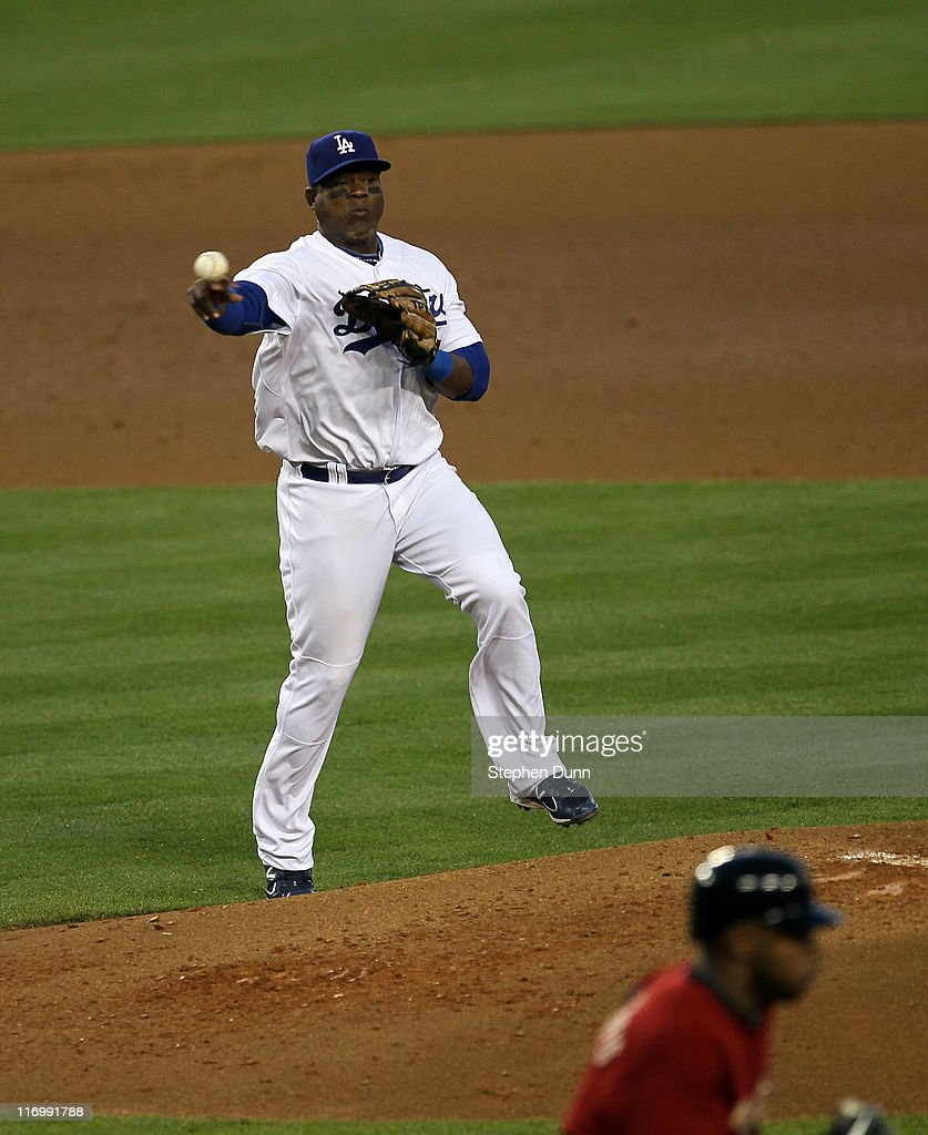 Third baseman <a gi-track='captionPersonalityLinkClicked' href=/galleries/search?phrase=Juan+Uribe&family=editorial&specificpeople=209187 ng-click='$event.stopPropagation()'>Juan Uribe</a> #5 of the Los Angeles Dodgers throws out Jason Bourgeois #11 of the Houston Astros in the fourth inning on June 18, 2011 at Dodger Stadium in Los Angeles, California.