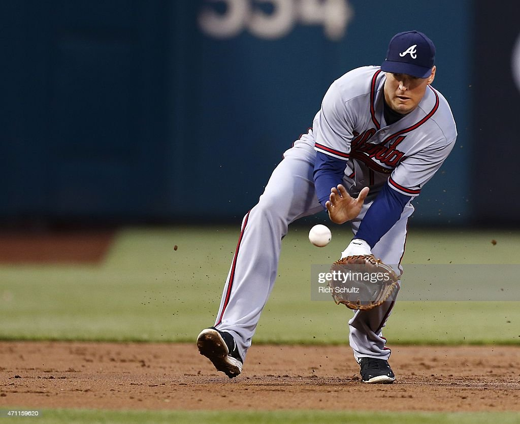 Third baseman <a gi-track='captionPersonalityLinkClicked' href=/galleries/search?phrase=Kelly+Johnson+-+Jugador+de+b%C3%A9isbol&family=editorial&specificpeople=4520789 ng-click='$event.stopPropagation()'>Kelly Johnson</a> #24 fields a ground ball hit by David Buchanan #55 of the Philadelphia Phillies during the third inning of a game at Citizens Bank Park on April 24, 2015 in Philadelphia, Pennsylvania. The Braves defeated the Phillies 5-3.