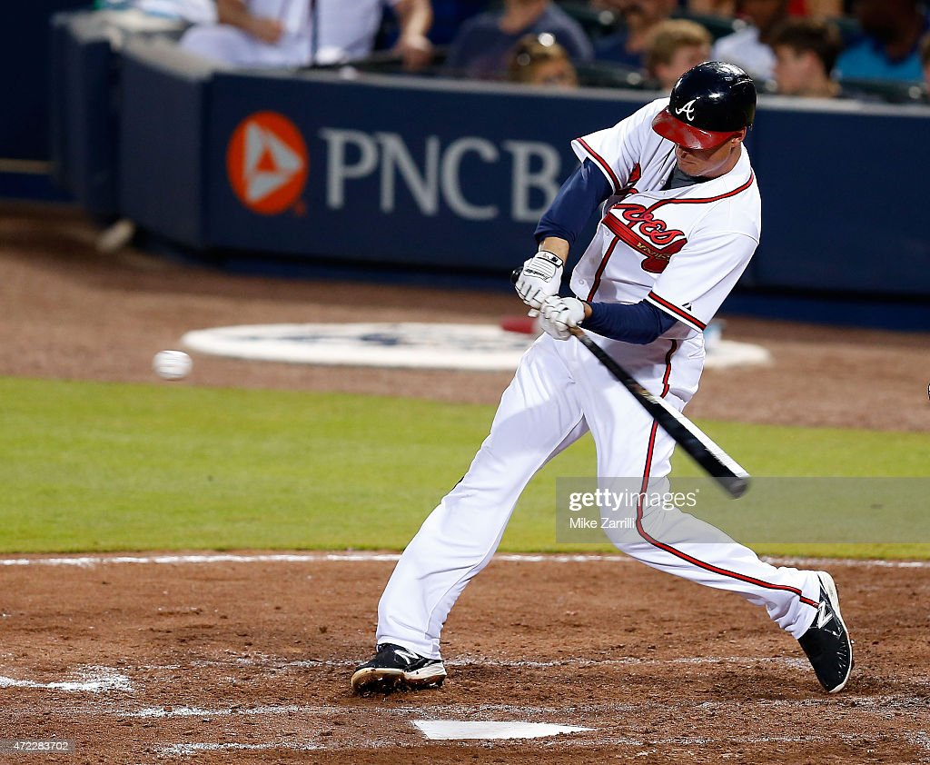 Third baseman <a gi-track='captionPersonalityLinkClicked' href=/galleries/search?phrase=Kelly+Johnson+-+Honkbalspeler&family=editorial&specificpeople=4520789 ng-click='$event.stopPropagation()'>Kelly Johnson</a> #24 of the Atlanta Braves connects for a single and his 1,000 career hit in the sixth inning in the game against the Philadelphia Phillies at Turner Field on May 5, 2015 in Atlanta, Georgia.