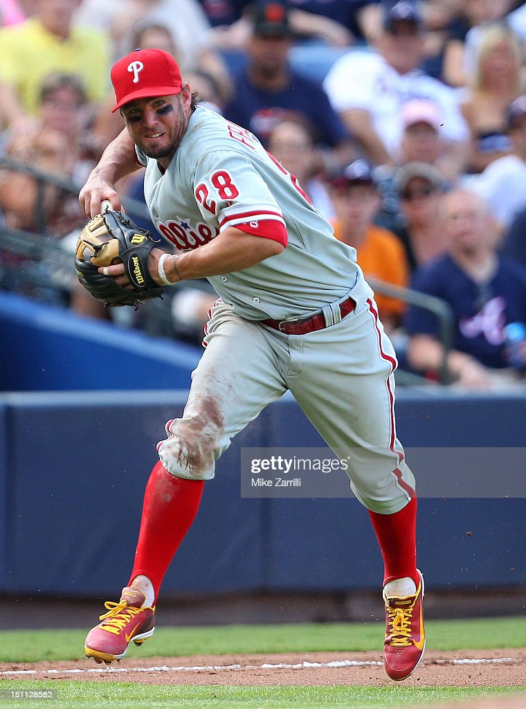 Third baseman <a gi-track='captionPersonalityLinkClicked' href=/galleries/search?phrase=Kevin+Frandsen&family=editorial&specificpeople=3982842 ng-click='$event.stopPropagation()'>Kevin Frandsen</a> #28 of the Philadelphia Phillies makes a play on a ground ball during the game against the Atlanta Braves at Turner Field on September 1, 2012 in Atlanta, Georgia.