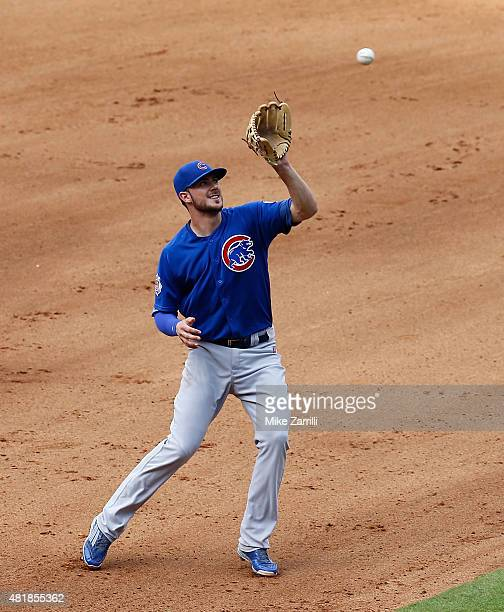 Third baseman Kris Bryant of the Chicago Cubs fields a high chopper during the game against the Atlanta Braves at Turner Field on July 19 2015 in...