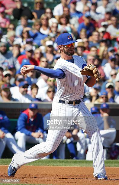 Third baseman Kris Bryant of the Chicago Cubs makes a play during the first inning against the St Louis Cardinals at Wrigley Field on September 20...