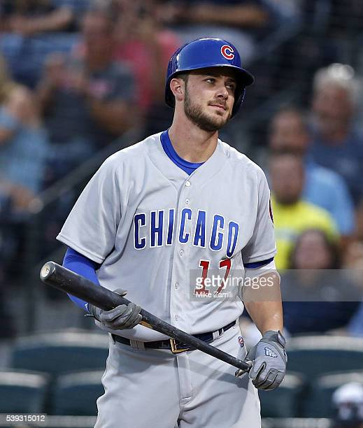 Third baseman Kris Bryant of the Chicago Cubs reacts to striking out in the fourth inning during the game against the Atlanta Braves at Turner Field...