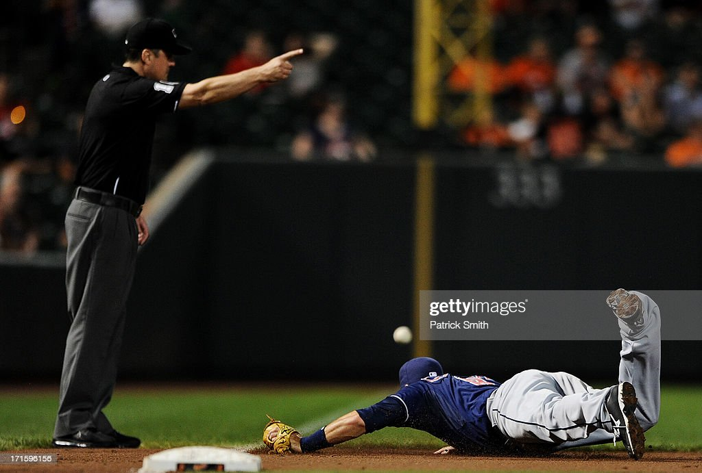 Third baseman <a gi-track='captionPersonalityLinkClicked' href=/galleries/search?phrase=Lonnie+Chisenhall&family=editorial&specificpeople=6796448 ng-click='$event.stopPropagation()'>Lonnie Chisenhall</a> #8 of the Cleveland Indians cannot grab a hit by Manny Machado #13 of the Baltimore Orioles (not pictured) in the seventh inning at Oriole Park at Camden Yards on June 26, 2013 in Baltimore, Maryland. The Cleveland Indians won, 4-3.