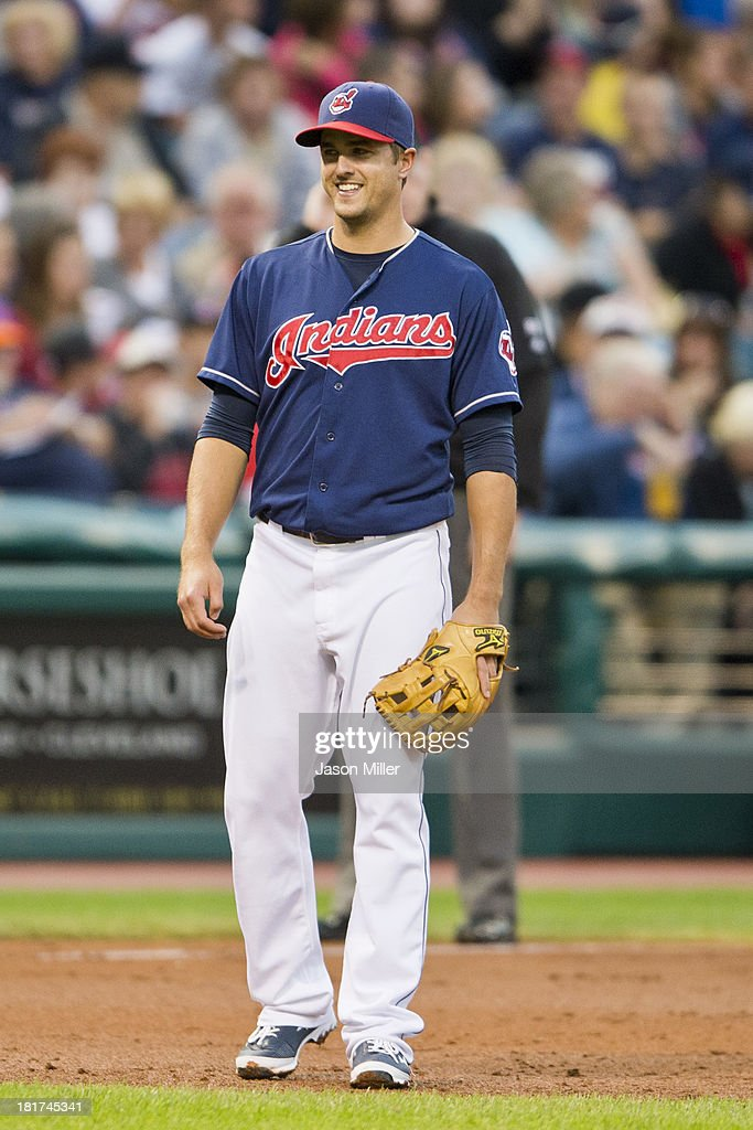 Third baseman Lonnie Chisenhall #8 of the Cleveland Indians smiles at his teammates during the first inning against the New York Mets at Progressive Field on September 6, 2013 in Cleveland, Ohio.