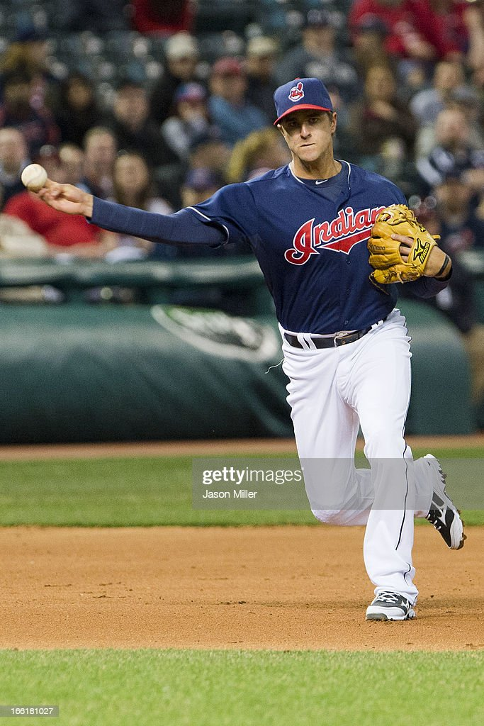 Third baseman <a gi-track='captionPersonalityLinkClicked' href=/galleries/search?phrase=Lonnie+Chisenhall&family=editorial&specificpeople=6796448 ng-click='$event.stopPropagation()'>Lonnie Chisenhall</a> #8 of the Cleveland Indians throws out Eduardo Nunez #26 of the New York Yankees during the seventh inning at Progressive Field on April 9, 2013 in Cleveland, Ohio.