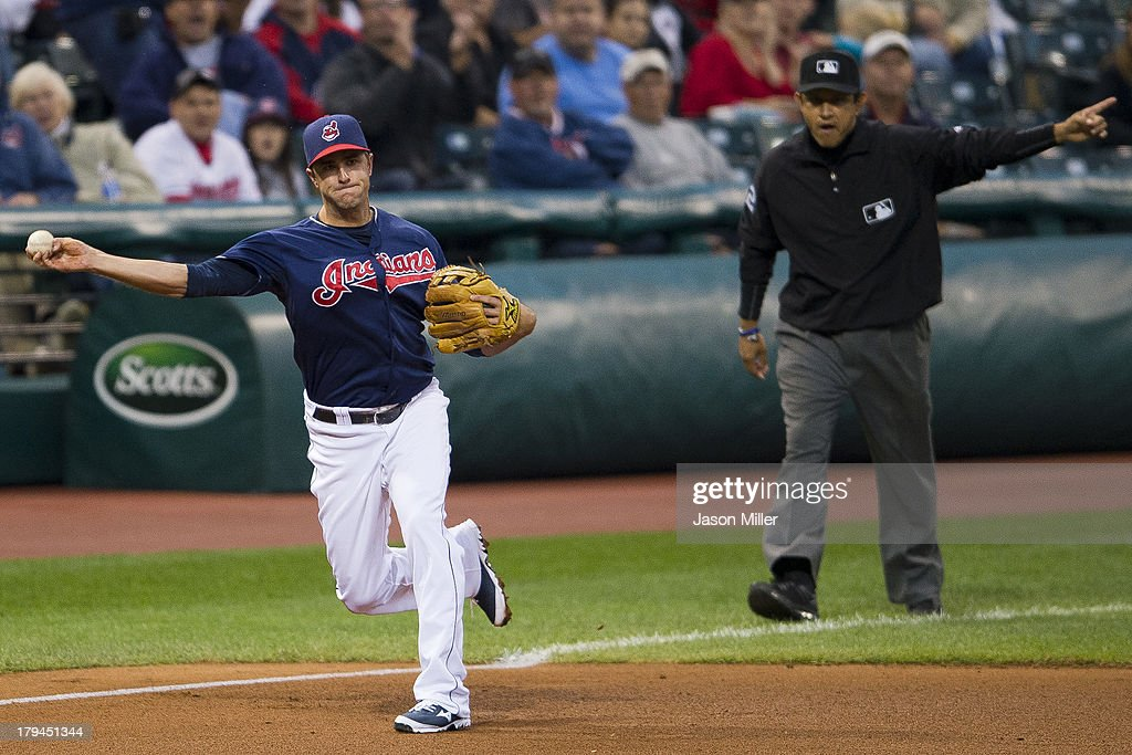 Third baseman <a gi-track='captionPersonalityLinkClicked' href=/galleries/search?phrase=Lonnie+Chisenhall&family=editorial&specificpeople=6796448 ng-click='$event.stopPropagation()'>Lonnie Chisenhall</a> #8 of the Cleveland Indians throws out Adam Jones #10 of the Baltimore Orioles at firs during the fourth inning at Progressive Field on September 3, 2013 in Cleveland, Ohio.