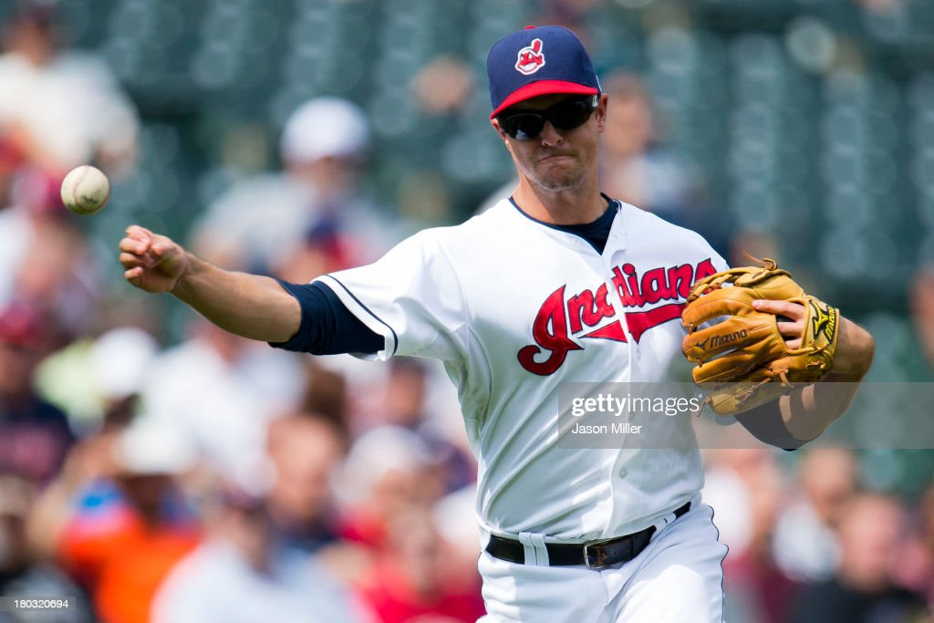 Third baseman <a gi-track='captionPersonalityLinkClicked' href=/galleries/search?phrase=Lonnie+Chisenhall&family=editorial&specificpeople=6796448 ng-click='$event.stopPropagation()'>Lonnie Chisenhall</a> #8 of the Cleveland Indians throws out Alcides Escobar #2 of the Kansas City Royals during the second inning at Progressive Field on September 11, 2013 in Cleveland, Ohio.